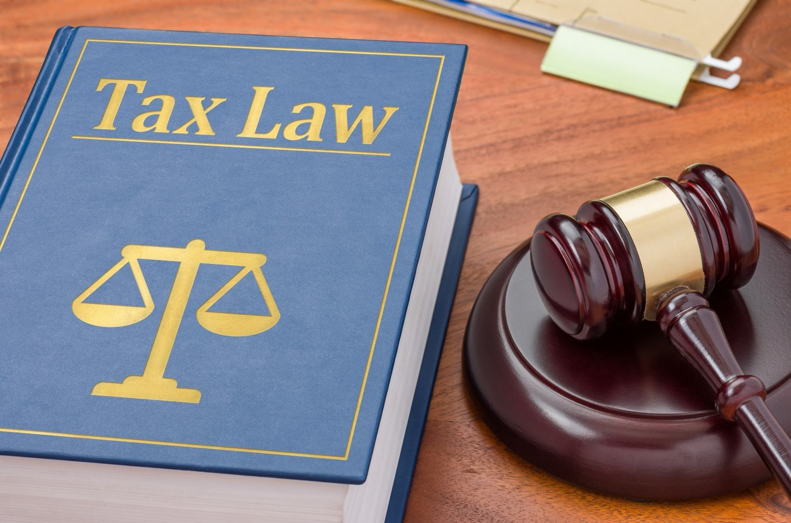 A law book with a gavel - Tax law
